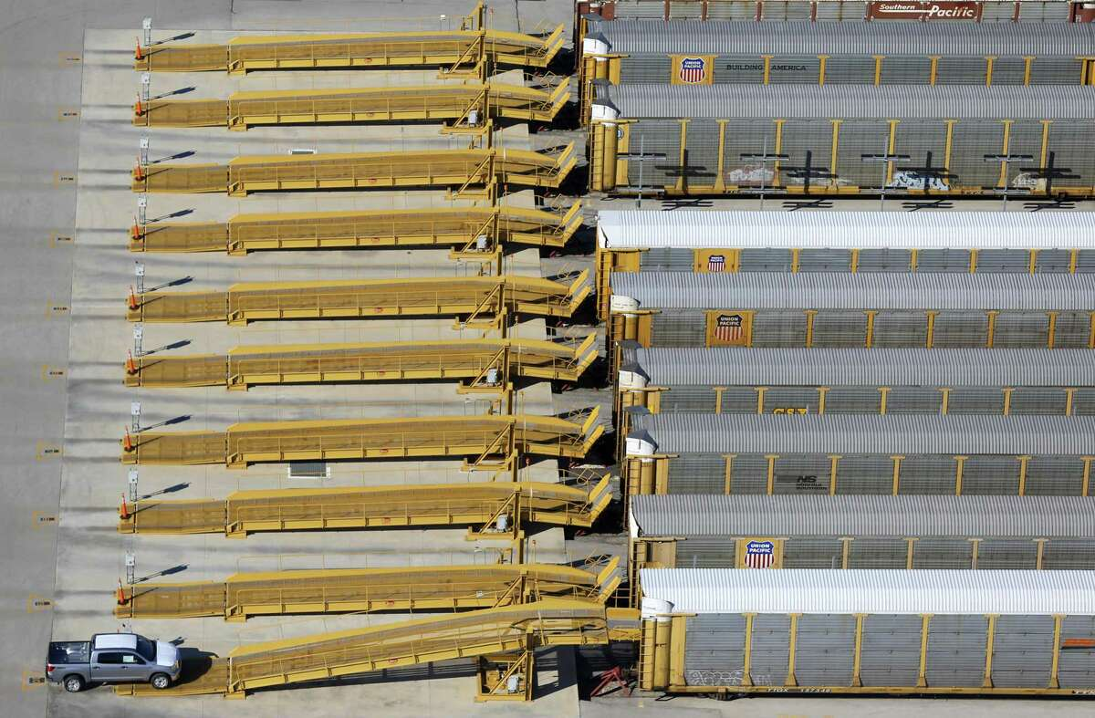 A Toyota Tundra pickup truck, seen in a Jan. 18, 2013 aerial picture, is driven onto a rail car for delivery after being built at the Toyota Motor Manufacturing, Texas, Inc. plant in south Bexar County. The TMMTX plant, announced in 2003, now builds Tundra and Tacoma pickup trucks.
