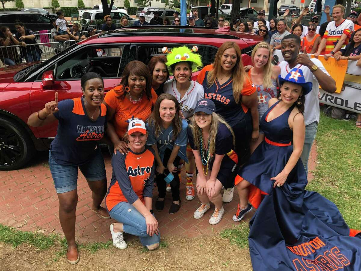 Sharon Russ, of Beaumont (far left), won a 2019 Chevrolet Trailblazer during a taping of 'The Ellen DeGeneres Show' at Minute Maid Park Thursday. Also competing was Jennifer Walsh (far right), wearing a custom gown made by a Lumberton seamstress.