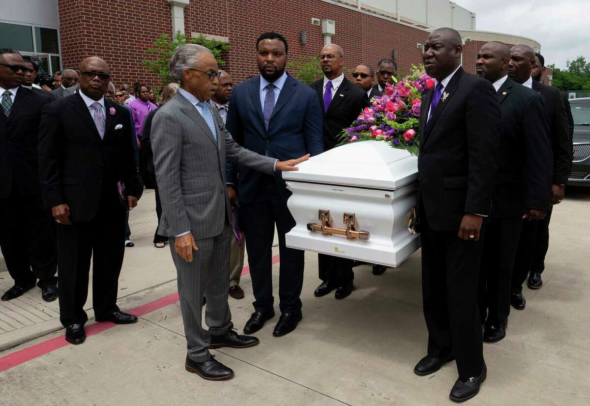 Rev. Al Sharpton touches Pamela Turner's casket before its placed into the hearse following the funeral service at Lilly Grove Missionary Baptist Church Thursday, May 23, 2019, in Houston. Turner was killed during an altercation with Baytown Police officer Juan Delacruz on Monday, May 13.