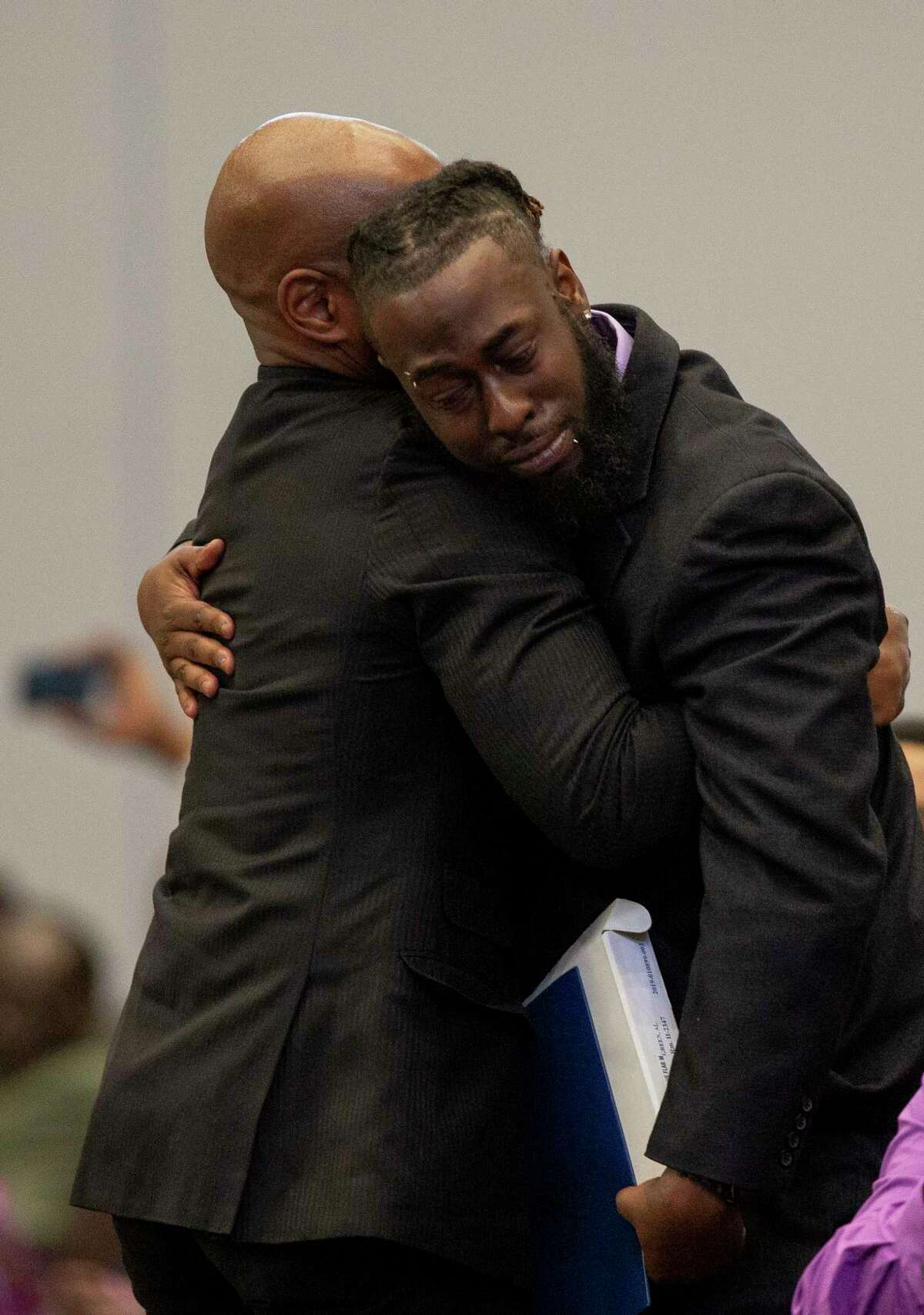 Cameron January, center, is comforted by family as the funeral service for his mother, Pamela Turner, begins at the Lilly Grove Missionary Baptist Church Thursday, May 23, 2019, in Houston. Turner was killed during an altercation with Baytown Police officer Juan Delacruz on Monday, May 13.