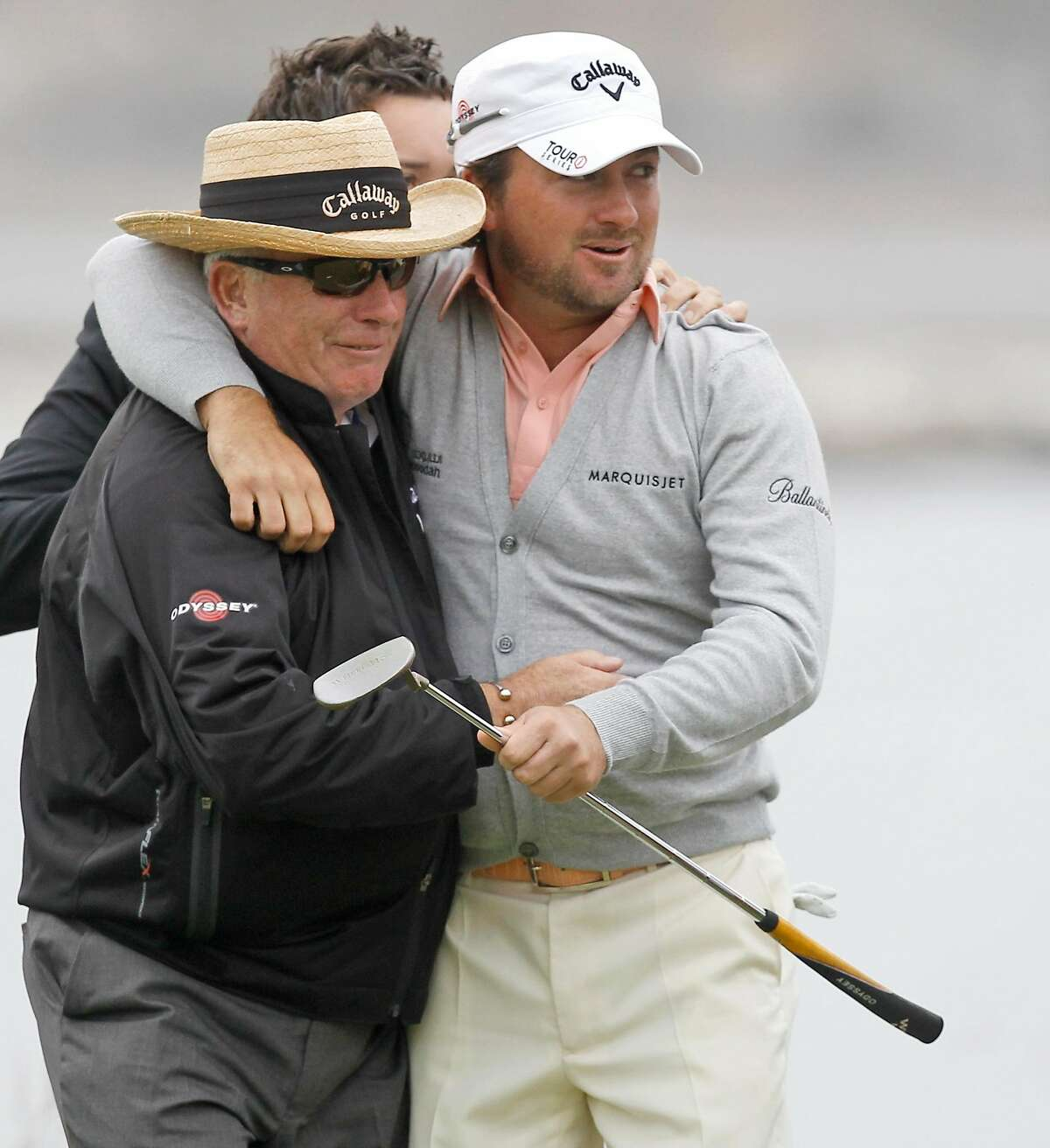 Graeme McDowell of Northern Ireland hugs his father Ken on the 18th green after winning the U.S. Open golf tournament Sunday, June 20, 2010, at the Pebble Beach Golf Links in Pebble Beach, Calif. (AP Photo/Chris Carlson)