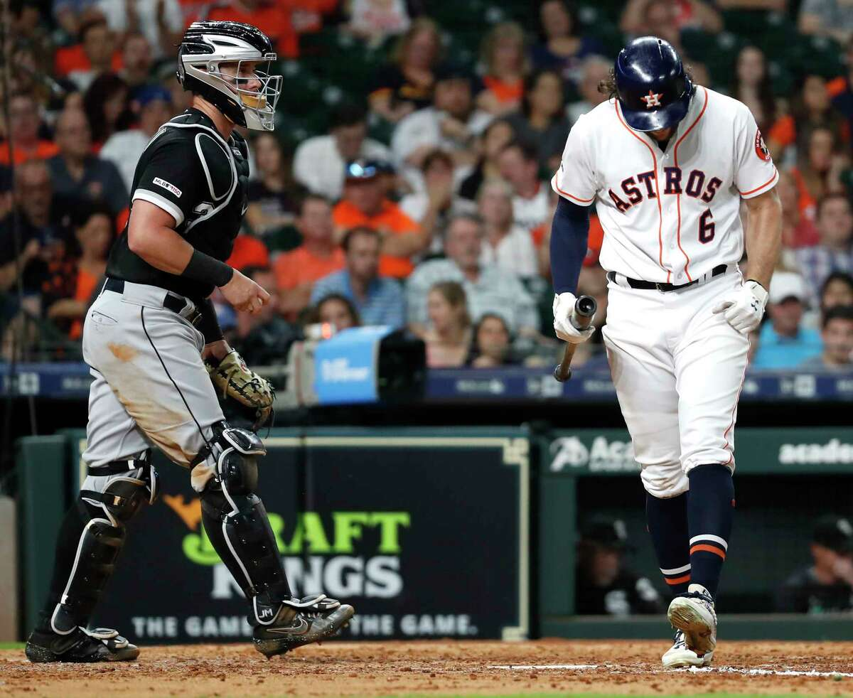 Houston Astros center fielder Jake Marisnick (6) reacts after striking out as he walks back to the dugout past Chicago White Sox catcher James McCann during the eighth inning of a major league baseball game at Minute Maid Park on Thursday, May 23, 2019, in Houston.