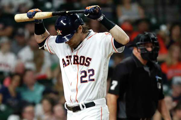 Houston Astros right fielder Josh Reddick places his bat on his head as he walks off the field after striking out against the Chicago White Sox during the eighth inning of a major league baseball game at Minute Maid Park on Thursday, May 23, 2019, in Houston.