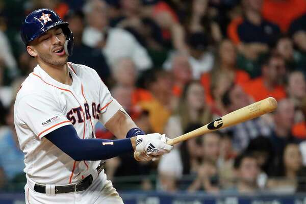Houston Astros shortstop Carlos Correa reacts as he flies out to Chicago White Sox center fielder Charlie Tilson during the fourth inning of a major league baseball game at Minute Maid Park on Thursday, May 23, 2019, in Houston.
