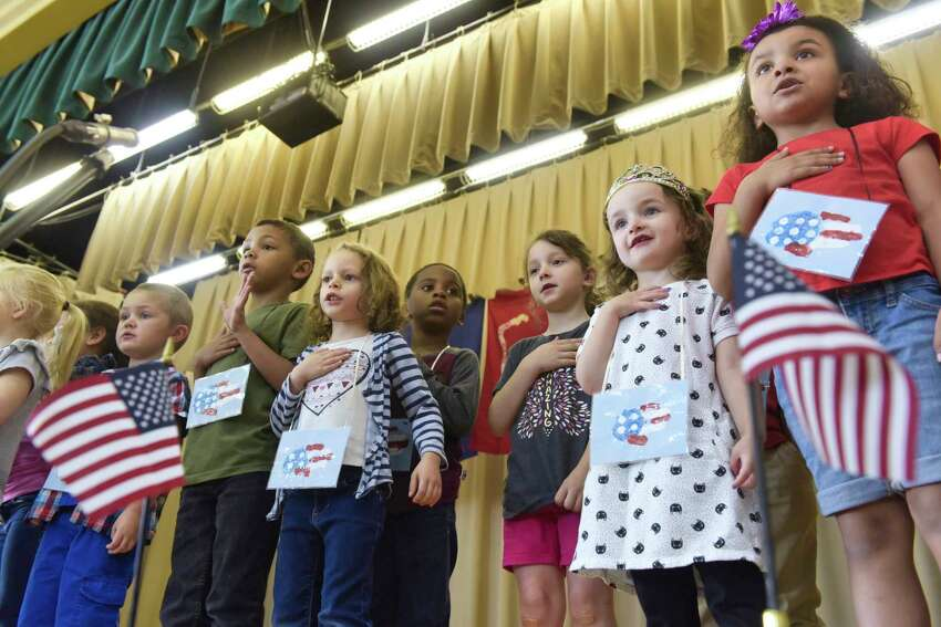Pre-K and kindergarten students at Heatly School lead everyone in the Pledge of Allegiance during the 20th Annual Memorial Day program at the school on Thursday, May 23, 2019, in Green Island, N.Y. (Paul Buckowski/Times Union)