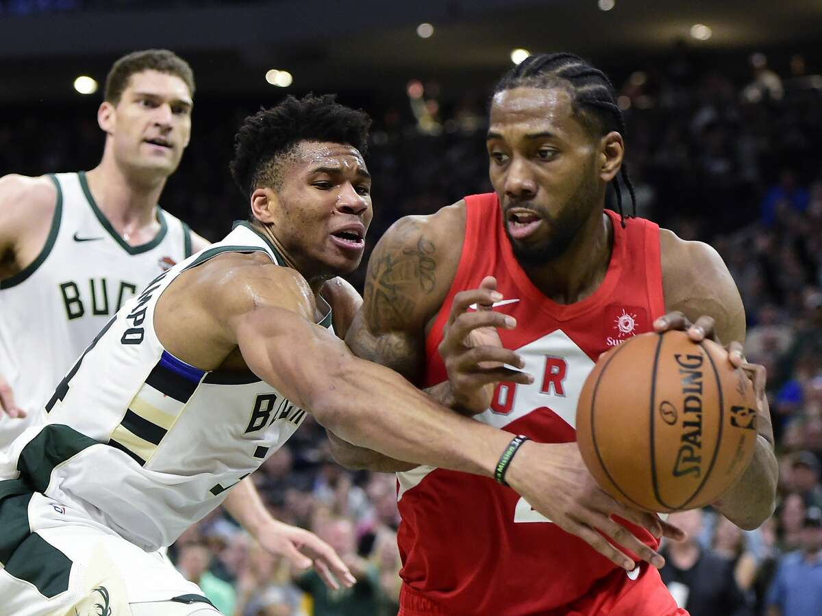 Milwaukee Bucks forward Giannis Antetokounmpo (34) defends against Toronto Raptors forward Kawhi Leonard (2) during the second half of Game 5 of the NBA basketball playoffs Eastern Conference finals in Milwaukee on Thursday, May 23, 2019. (Frank Gunn/The Canadian Press via AP)