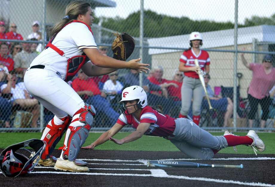 Mia Torres of Fredericksburg slides in safely past catcher Sydnie Booker of Navarro during Game 2 of the Region IV-4A final series in Dripping Springs on Thursday, May 23, 2019. Photo: Billy Calzada, Staff / Staff Photographer / Billy Calzada