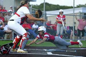 Mia Torres of Fredericksburg slides in safely past catcher Sydnie Booker of Navarro during Game 2 of the Region IV-4A final series in Dripping Springs on Thursday, May 23, 2019.