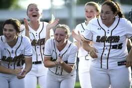 The Navarro Panthers cheer as teammate Emily Hinkelmann rounds the bases after hitting a homerun against Fredericksburg during Game 2 of the Region IV-4A final series in Dripping Springs on Thursday, May 23, 2019.
