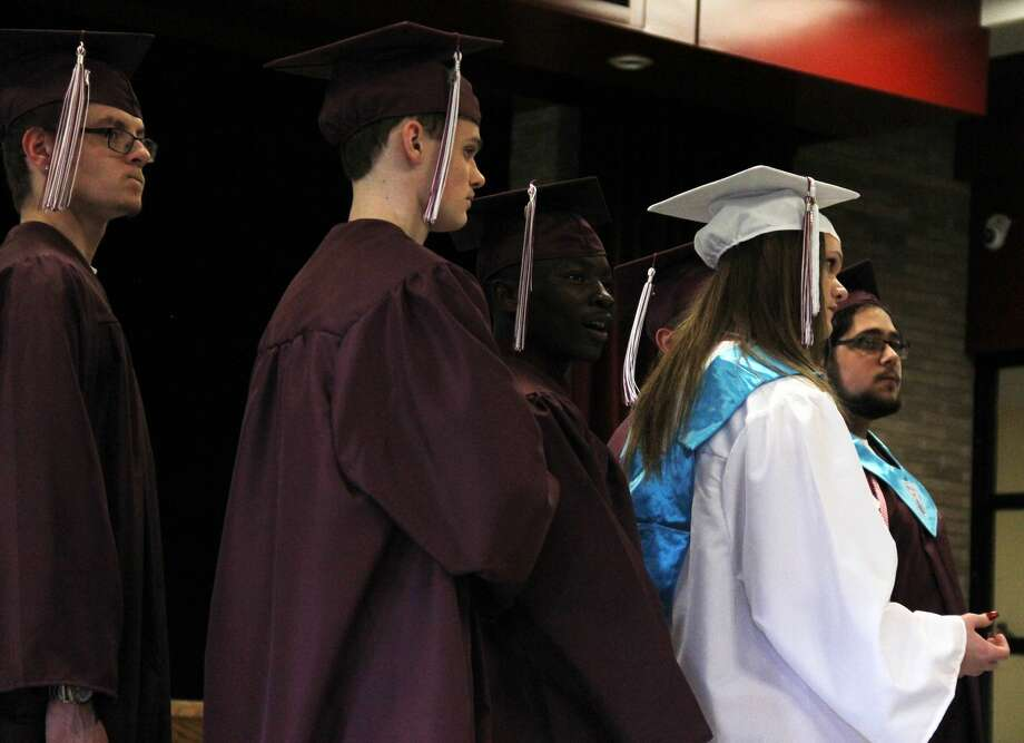 Students and family celebrates the Cass City High School graduating class of 2019. Photo: Andrew Mullin/Huron Daily Tribune