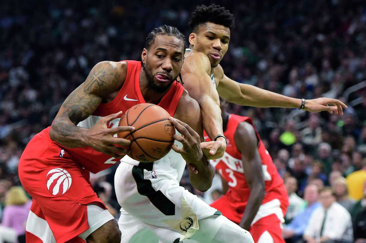 Toronto Raptors forward Kawhi Leonard (2) steals the ball from Milwaukee Bucks forward Giannis Antetokounmpo (34) during the first half of Game 5 of the NBA basketball playoffs Eastern Conference finals in Milwaukee on Thursday, May 23, 2019. (Frank Gunn/The Canadian Press via AP)