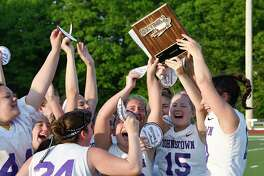 Johnstown players celebrate a 16-10 win against Holy Names during a Section II Class D Girls' high school Lacrosse championship Thursday, May 9, 2019, in Rotterdam, N.Y. Johnstown won (Hans Pennink / Special to the Times Union)