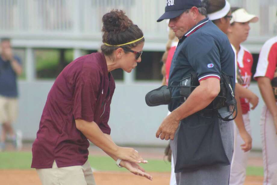 An unhappy Deer Park head coach Errica Cantu argues her case to the home-plate umpire over an interference call in the third inning Thursday night. Photo: Robert Avery