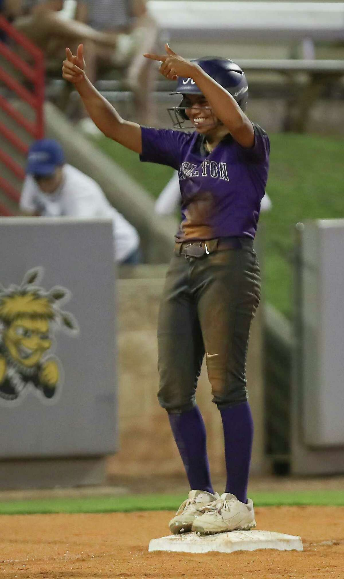Angleton #Angel Jasso gives thumbs up after hitting a triple against Barbers Hill Thursday, May 23, 2019, in Houston.