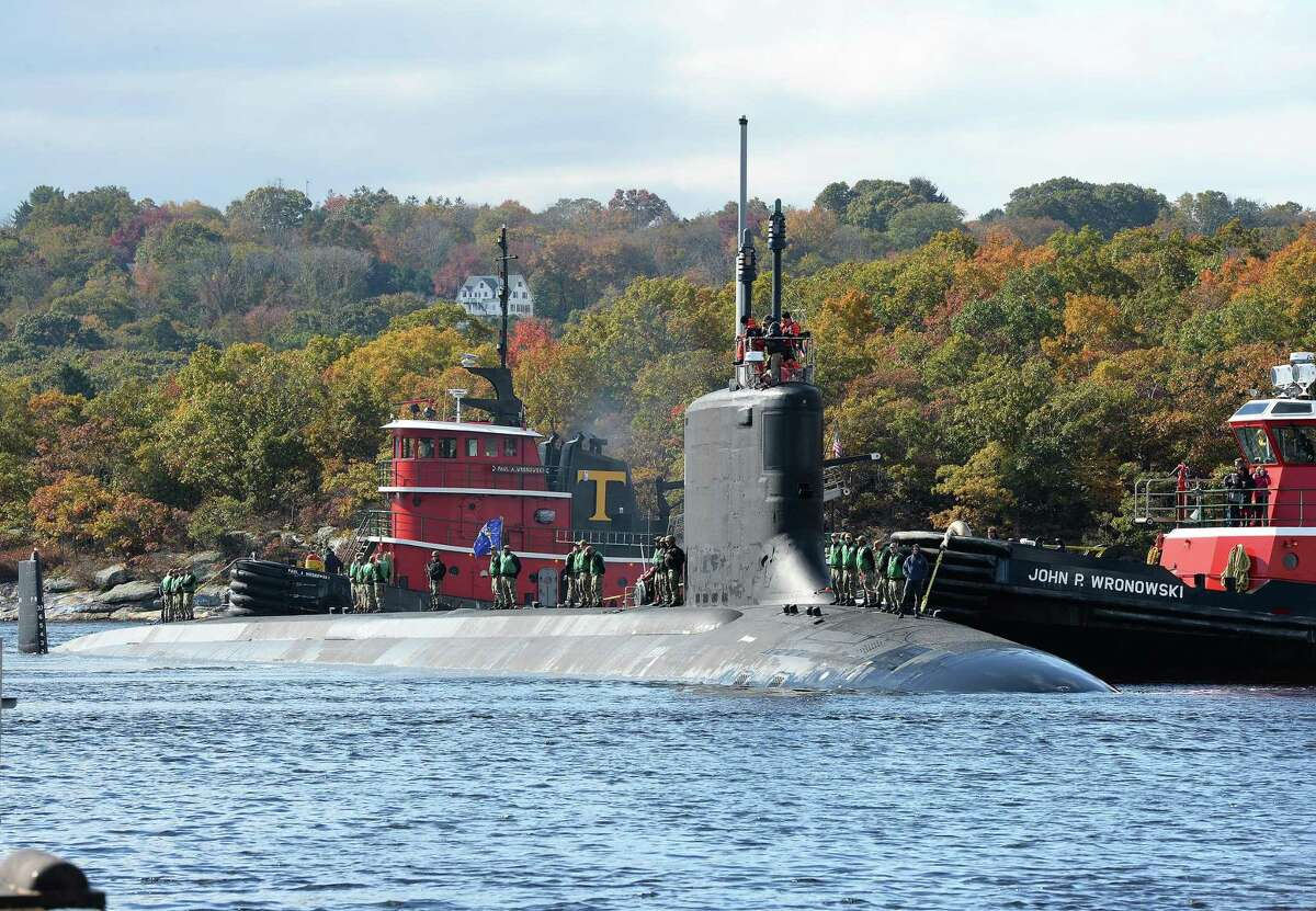 The Virginia-class, fast-attack submarine USS Indiana (SSN 789) transits the Thames River as it arrives at the Naval Submarine Base New London in Groton.