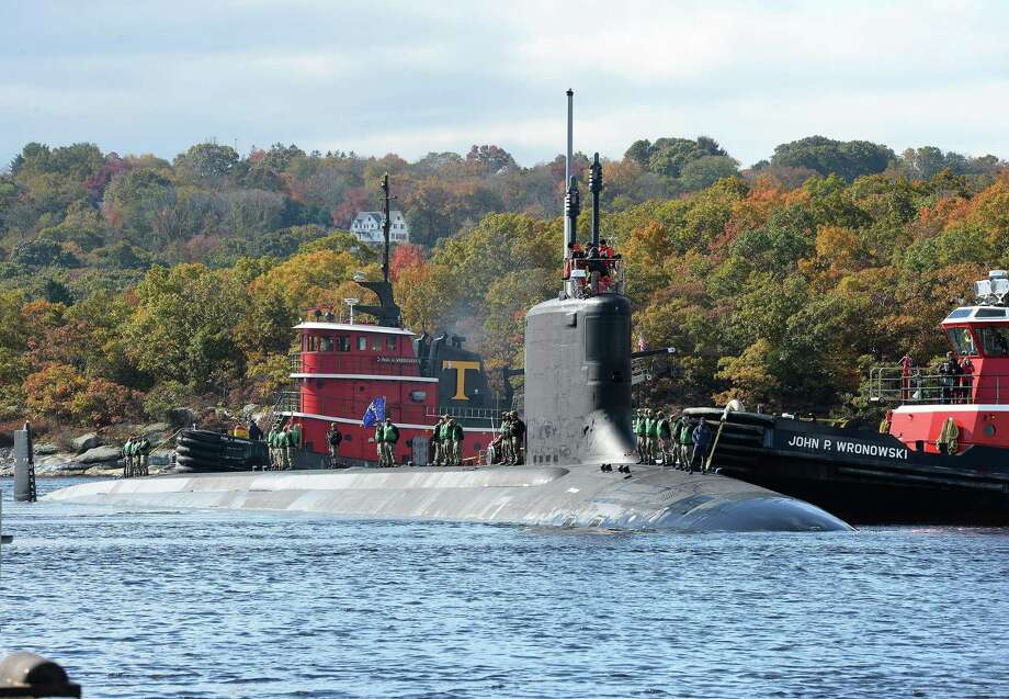 The Virginia-class, fast-attack submarine USS Indiana (SSN 789) transits the Thames River as it arrives at the Naval Submarine Base New London in Groton. Photo: Photo By MC1 Steven Hoskins / Naval Submarine Support Center / Public Domain