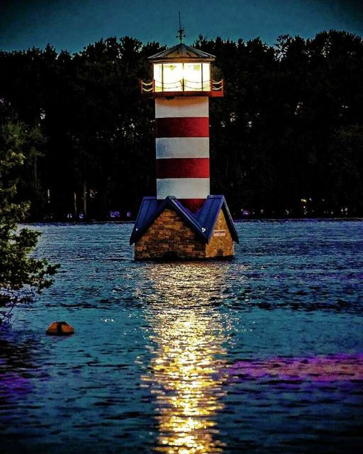The Grafton lighthouse sends a reflection off the surface of 28-foot floodwaters. The National Weather Service forecasts a crest of 31.1 feet to happen Sunday. It would be the fifth highest crest on record. Grafton Mayor Rick Eberlin said he's met with experts predicting 34 or 35 feet, which would be the second highest on record. Photo: Nathan Woodside | Hearst Illinois