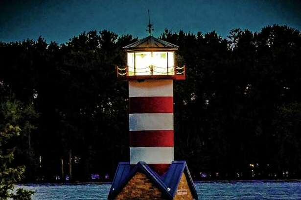 The Grafton lighthouse sends a reflection off the surface of 28-foot floodwaters. The National Weather Service forecasts a crest of 31.1 feet to happen Sunday. It would be the fifth highest crest on record. Grafton Mayor Rick Eberlin said he's met with experts predicting 34 or 35 feet, which would be the second highest on record.