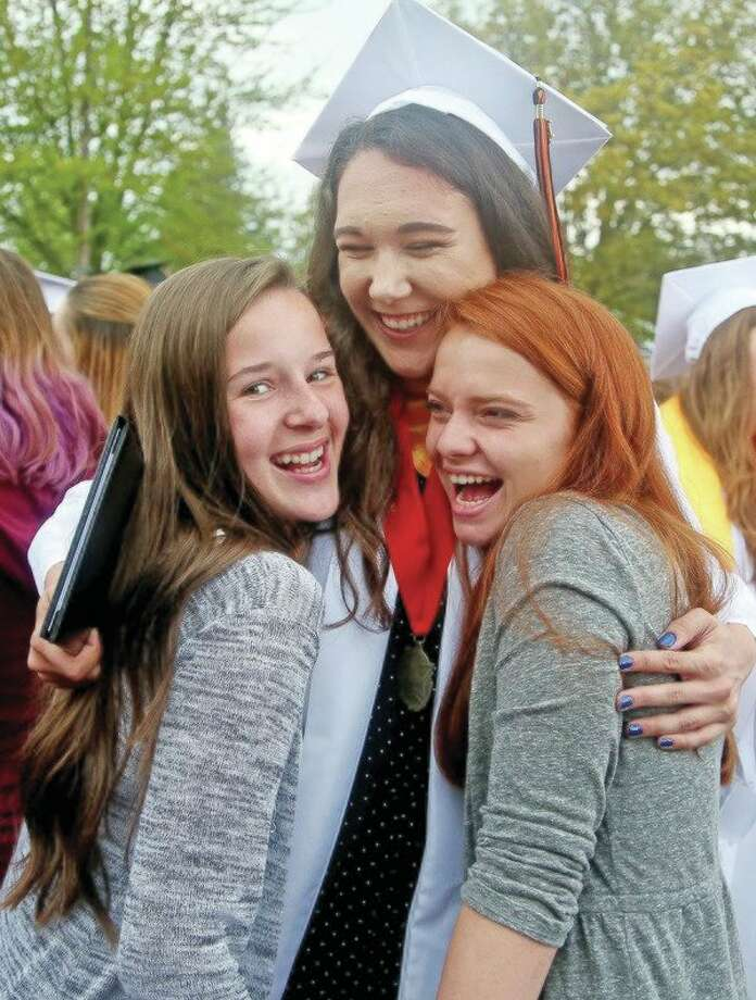 Sadie Souva is all smiles as she celebrates with friends, Sunday, following Ubly's Graduation. For more pictures of the ceremony, see Page 8A. (Paul P. Adams/Huron Daily Tribune)