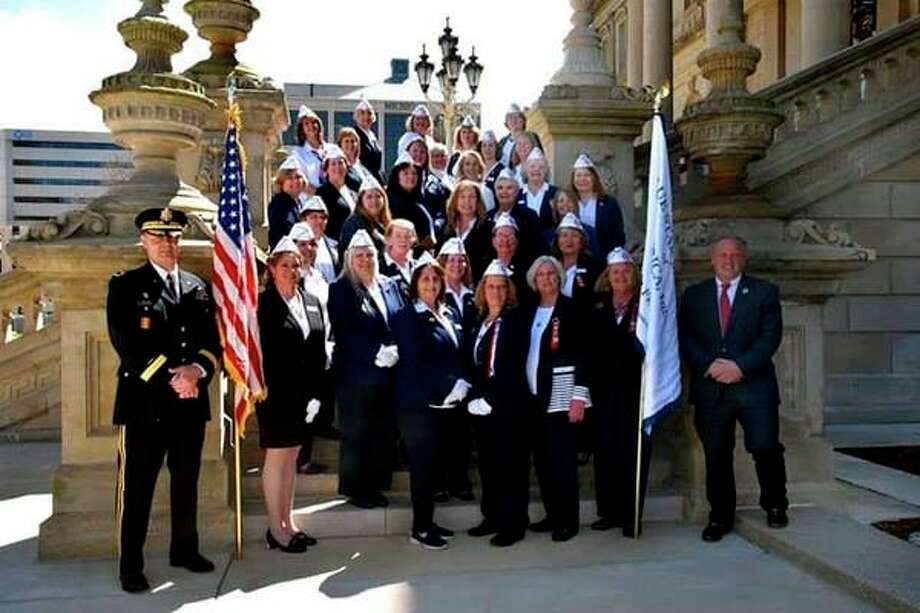 On May 4, State Rep. Luke Meerman and Brigadier General Lawrence Schloegel, along with members of the Michigan State Police, thanked and honored members of the Michigan's Blue Star Mothers for their service and dedication to our military. After the ceremony, the Blue Star Mothers got a tour of the Michigan State Capitol Building. (Submitted Photo)