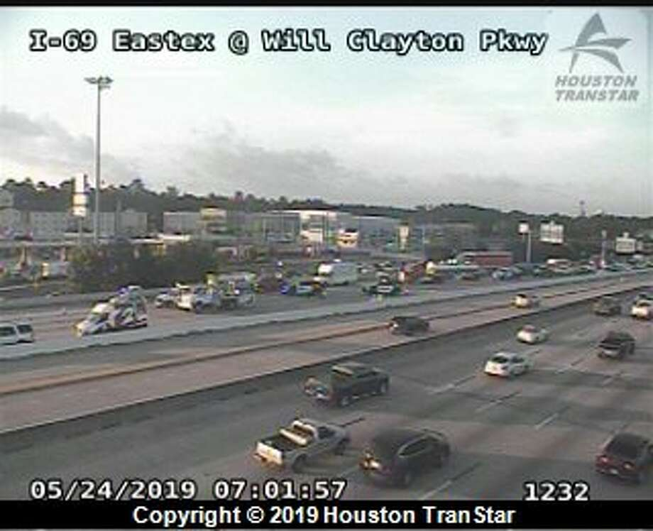 At least four lanes were blocked on the Eastex Freeway while emergency crews repaired a piece of metal in the road. Multiple vehicles were damaged. Photo: Houston TranStar