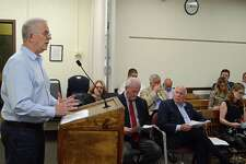 Donald O'Day, chairman of the CMS Building Committee, shares an update at the Board of Finance meeting on Thursday, May 23, 2019, in Westport, Conn.