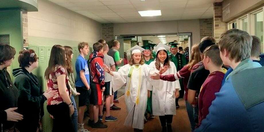 After their graduation practice Thursday morning, the Laker Class of 2019 walked the hallways at the secondary and elementary schools. Students and staff members cheered them on and gave the seniors high fives. This event has become a tradition at Lakers. It's a way for seniors to celebrate graduation, and it's a reminder for younger students that graduation is what they're working toward every day. (Submitted Photo)