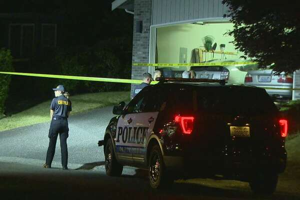Officers investigate after a man and child were found dead inside a Maple Valley home.