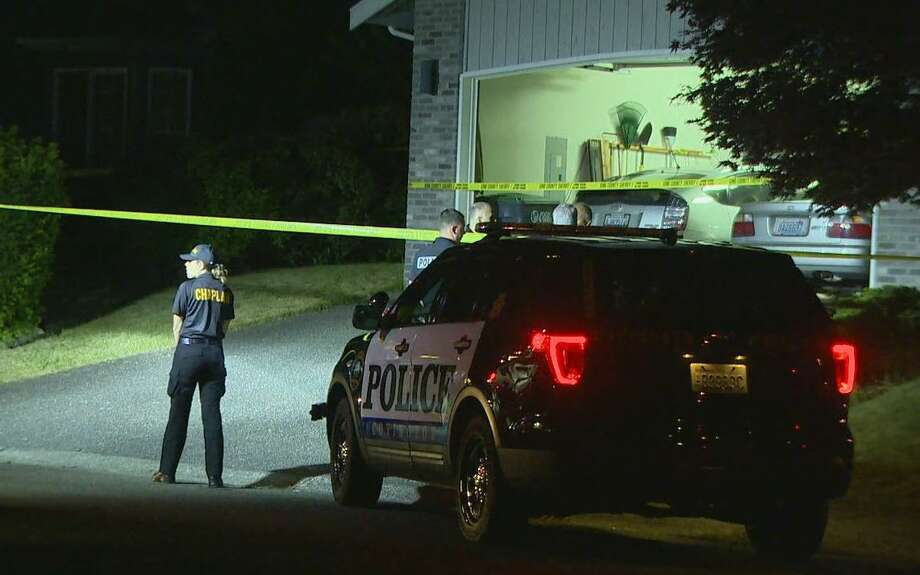 Officers investigate after a man and child were found dead inside a Maple Valley home. Photo: KOMO Photo