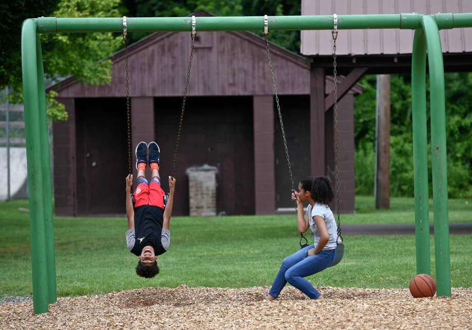 File photo of children play on the swings in Young's Field Park, New Milford, Conn. Photo: H John Voorhees III / Hearst Connecticut Media / The News-Times