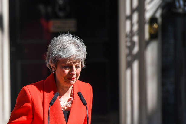 Theresa May, U.K. prime minister, reacts as she delivers a speech announcing her resignation outside 10 Downing Street in London on May 24, 2019.