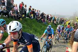 Professional women's racers suffer up the Oude Kwaremont, a short, steep climb where the winner made her decisive move in this year's Tour of Flanders.