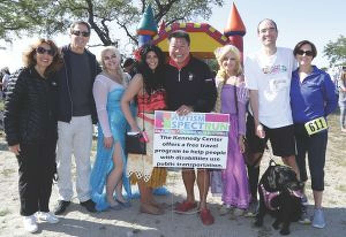 The 3rd annual Kennedy Center Autism SpectRUN was held at Jennings Beach in Fairfield. Elaine Schwartz of Trumbull, with her husband Martin D. Schwartz, President and CEO of The Kennedy Center, State Senator Tony Hwang (28th District) flanked by princesses, and Dr. Pietro Andres and his wife Kristine of Fairfield gather for the event that raised $25,000.