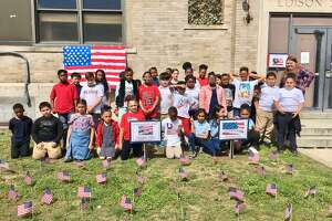 Sixth and third graders at Edison School in Bridgeport salute Memorial Day