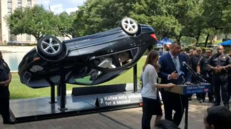"The family of Kailee Mills stands in front of a sculpture portraying the moment before the crash that killed their daughter. The unveiling ceremony in Hermann Square Park outside Houston City Hall on May 22 is one of 13 stops on a tour for TxDOT's 2019 ""Click it or Ticket"" campaign. Photo: Courtesy Of Diana Mills/Kailee Mills Foundation Facebook Page"