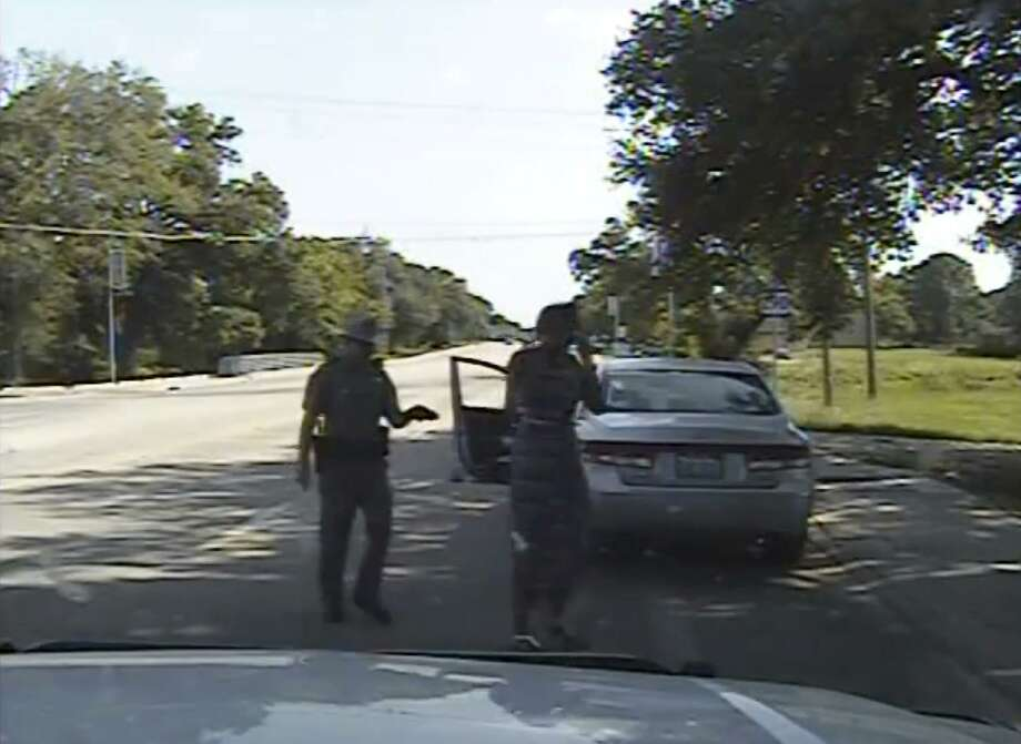 FILE - In this July 10, 2015, file frame from dashcam video provided by the Texas Department of Public Safety, Trooper Brian Encinia arrests Sandra Bland after she became combative during a routine traffic stop in Waller County, Texas. Texas authorities are expected to face sharp questioning over why cellphone video Sandra Bland took during her confrontational 2015 traffic stop never publicly surfaced until May 2019. (Texas Department of Public Safety via AP, File) Photo: Andy Alfaro, HOGP / Associated Press / Texas Department of Public Safety