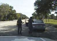FILE - In this July 10, 2015, file frame from dashcam video provided by the Texas Department of Public Safety, Trooper Brian Encinia arrests Sandra Bland after she became combative during a routine traffic stop in Waller County, Texas. Texas authorities are expected to face sharp questioning over why cellphone video Sandra Bland took during her confrontational 2015 traffic stop never publicly surfaced until May 2019. (Texas Department of Public Safety via AP, File)