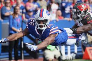 BUFFALO, NY - OCTOBER 22: Taiwan Jones #26 of the Buffalo Bills dives in pursuit of an overthrown pass but cannot get to the ball during NFL game action against the Tampa Bay Buccaneers at New Era Field on October 22, 2017 in Buffalo, New York. (Photo by Tom Szczerbowski/Getty Images)