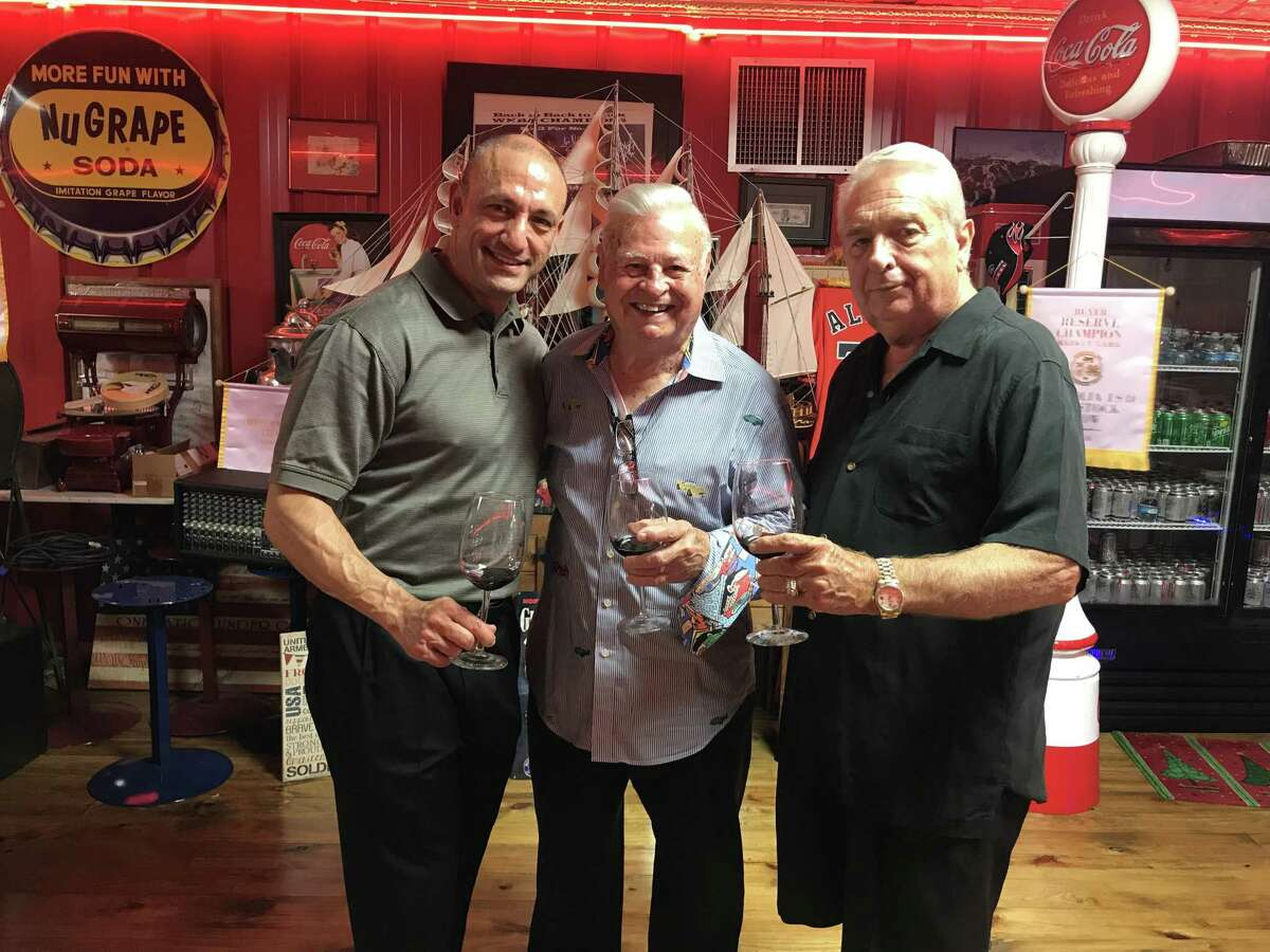 Pictured from left areCary Attar founder of Fielding's restaurant, Tony Gullo and Carl Howard sharing a glass of wine from Attar's collection at a May 18 wine dinner benefiting the Crighton Theatre.