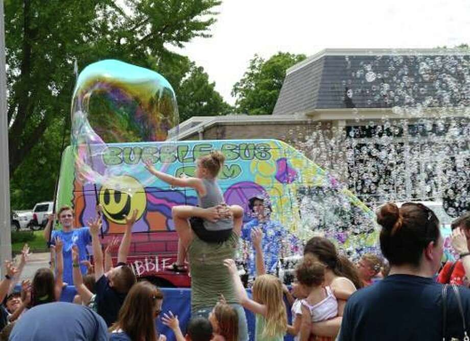 A bubble buss is part of the Summer Reading Kickoff Party at the Edwardsville Library on Wednesday. Photo: For The Intelligencer