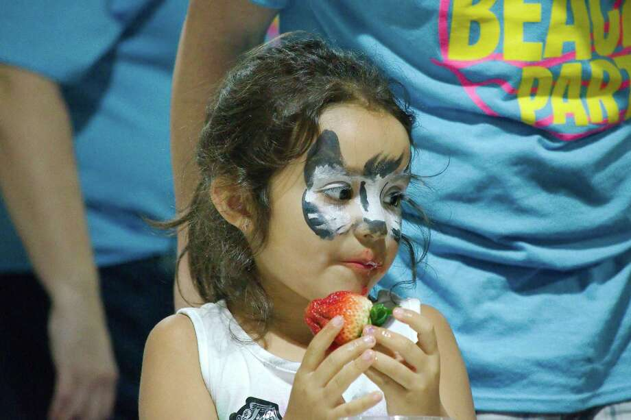 Kaila Bustos bites into some strawberries in a contest at the Pasadena Strawberry Festival, which reported an increase in attendance this year. Photo: Kirk Sides / Staff Photographer / © 2019 Kirk Sides / Houston Chronicle