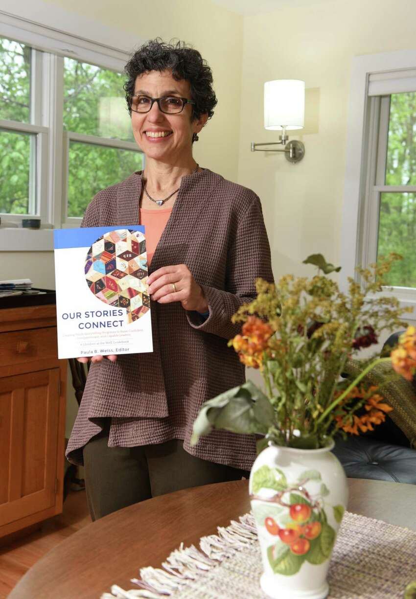Paula Weiss holds the book she edited all on the art and methods of in-person storytelling, titled