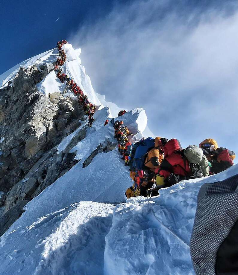 "This handout photo taken on May 22, 2019 and released by climber Nirmal Purja's Project Possible expedition shows heavy traffic of mountain climbers lining up to stand at the summit of Mount Everest. - Many teams had to line up for hours on May 22 to reach the summit, risking frostbites and altitude sickness, as a rush of climbers marked one of the busiest days on the world's highest mountain. (Photo by Handout / Project Possible / AFP) / RESTRICTED TO EDITORIAL USE - MANDATORY CREDIT ""AFP PHOTO / PROJECT POSSIBLE"" - NO MARKETING NO ADVERTISING CAMPAIGNS - DISTRIBUTED AS A SERVICE TO CLIENTS ---HANDOUT/AFP/Getty Images Photo: Handout, AFP/Getty Images"