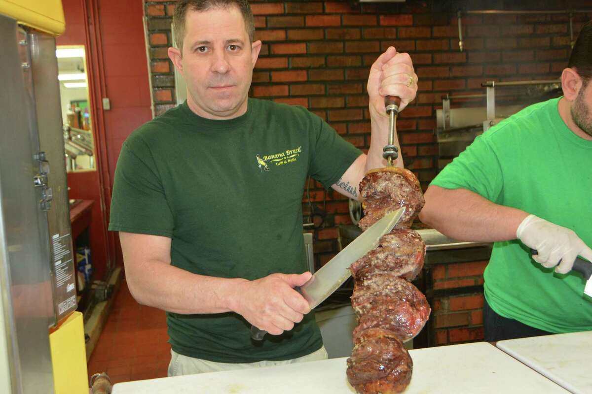 Beef is ready for carving at Banana Brazil. Below, the bacon-wrapped chicken.