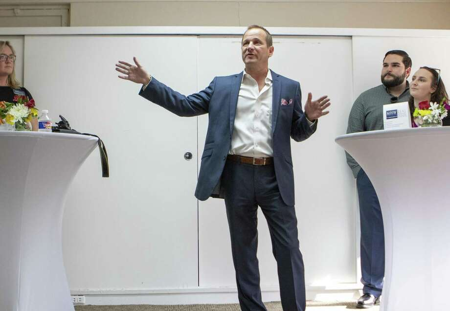Jody Czajkoski, MHW Commercial Real Estate founder and principal of investment, explains plans for renovating the historic Carter building during a reception Thursday, May 23, 2019 in Conroe. Photo: Cody Bahn, Houston Chronicle / Staff Photographer / © 2018 Houston Chronicle