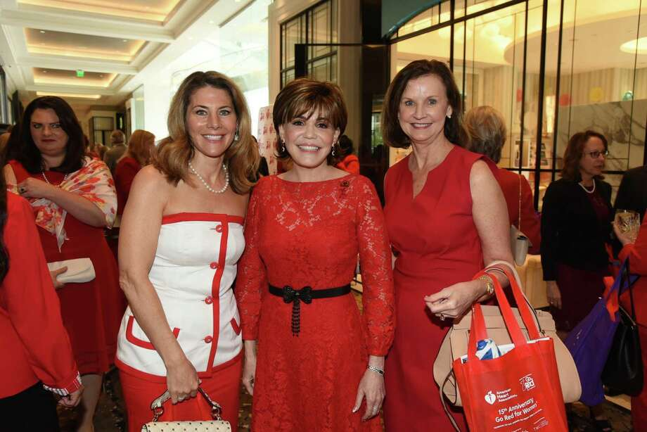 Allison Lewis, from left, Hallie Vanderhider and Sandy Scott were among attendees at the 15th annual Go Red for Women Luncheon at the Post Oak Hotel. Vanderhider chaired the event. Photo: American Heart Association / American Heart Association