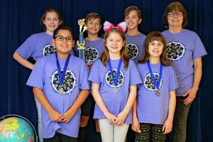 One of this year's two Odyssey of the Mind teams from Terrace Elementary is competing at the world finals at Michigan State University. Back from left:  Hannah, Tomasz, Jonathan, and Iris Story (coach). Front from left: Ryan, Anusia, Avery.