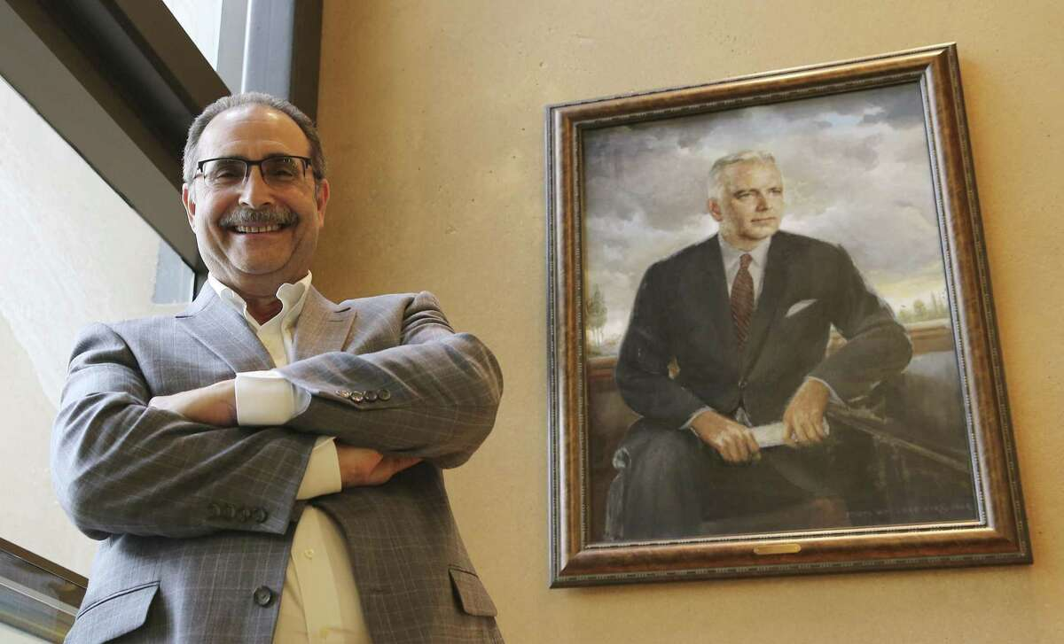 Dr. Larry Schlesinger, president and CEO of Texas Biomedical Research Institute, seen posing with a portrait of the institute's founder, Tom Slick, offers a forward vision of the research facility which has been established in San Antonio since 1952. The institute is currently undergoing growth and expansion. The National Institutes of Health has awarded Mymetics and Texas Biomed an $8.6M five-year grant for a for novel HIV vaccine study, they hired a new Assistant Director for Research Support at the Southwest National Primate Research Center, Staff Scientist Christopher Chen, Ph.D., who is in charge of improving operations at one of only seven national primate research centers in the country. (Kin Man Hui/San Antonio Express-News)