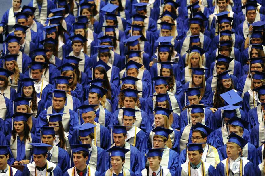 Friendswood High School students wait to walk across the stage during a previous graduation ceremony. This year's event, which had been scheduled for July 11 indoors at Grace Community Church, is now planned for 7 p.m. June 5 at Challenger Columbia Stadium in Webster. / Internal