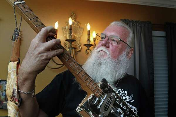 Charlie Rehfeld, who builds cigar box guitars, plays his favorite instrument, complete with a 1960 black-and-white Texas license plate on the front.
